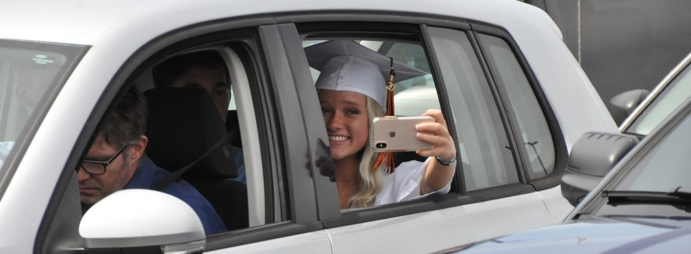 Student taking a picture during graduation.