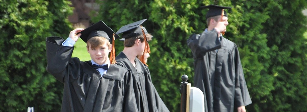Graduates prepair to flip their tassel.