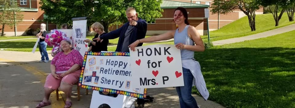 Sherry Patterson relaxes outside with teachers to celebrate her retirement.