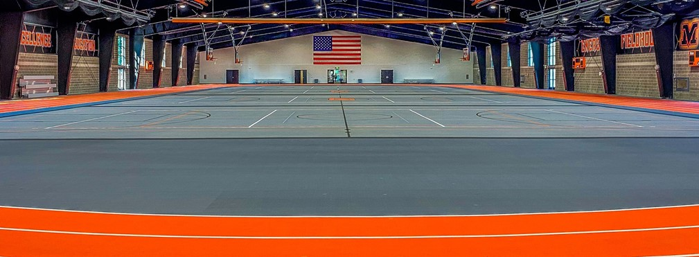 Interior of the large track and basketball courts of Energy Fieldhouse.