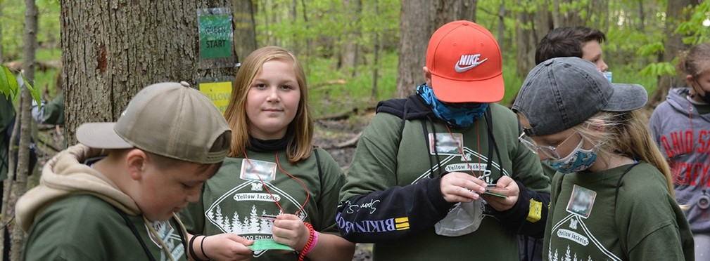 Students working on orienteering challenge during Heartland outdoor education experience.