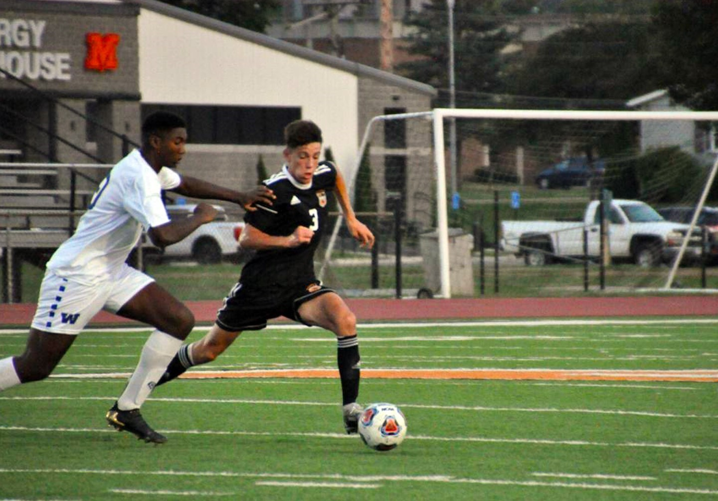 Mount Vernon soccer player kicking the ball past a Wooster opponent.