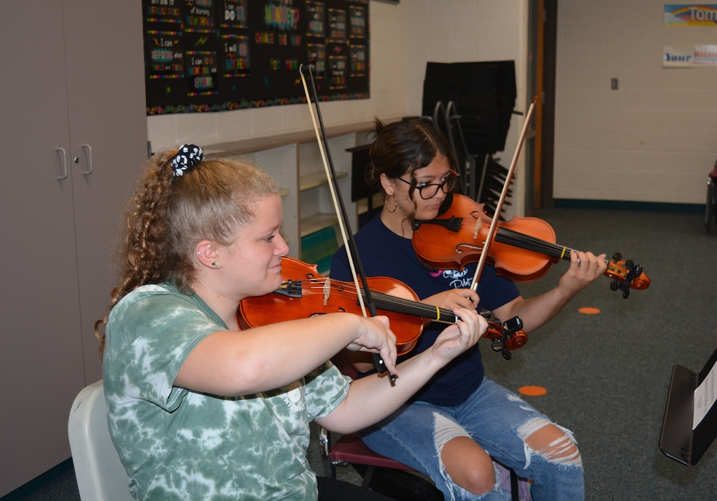 Students playing the violin in Orchestra class.