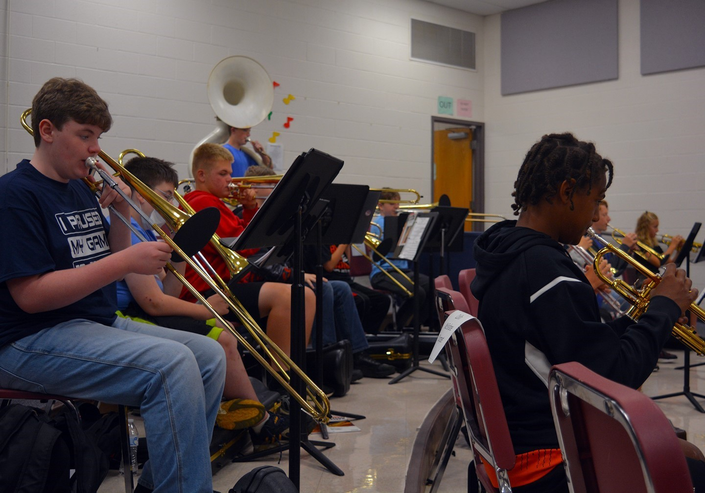 Students practicing in the horn section of the band classroom.