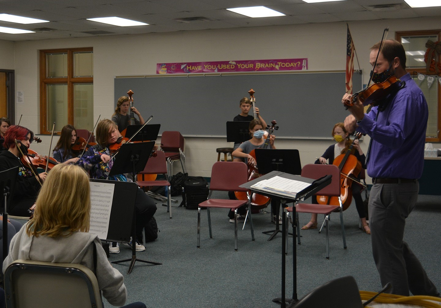 Mr. Japikse instructing the students during Orchestra class.