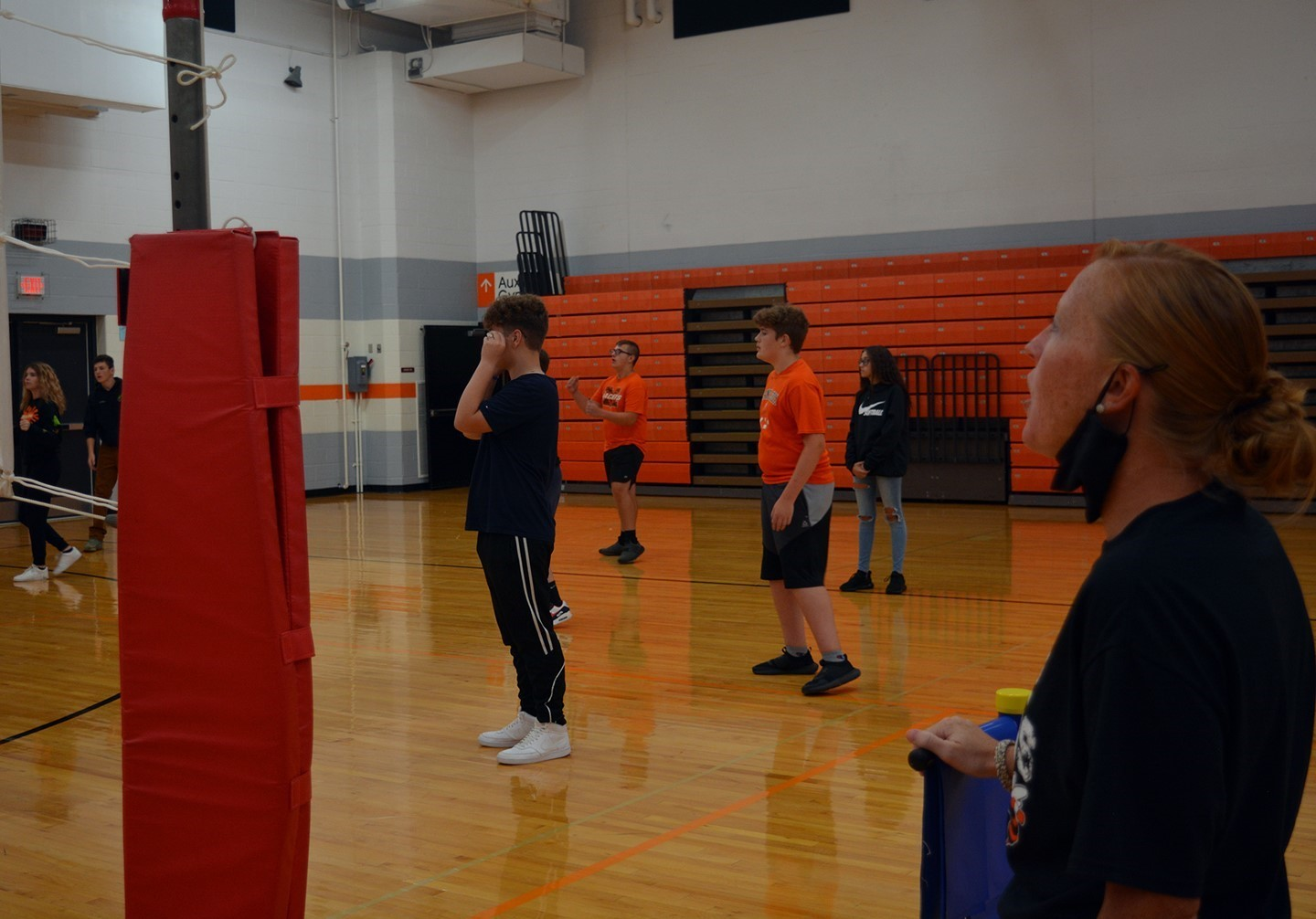 Ms. Fuller teaching volleyball skills in PE class.