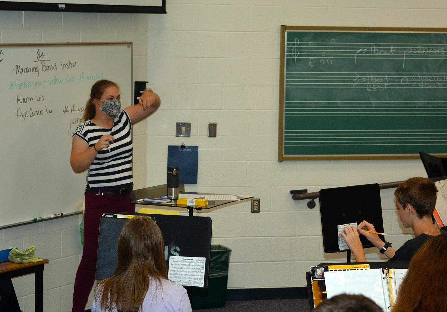 Band teacher instructing students in the classroom.