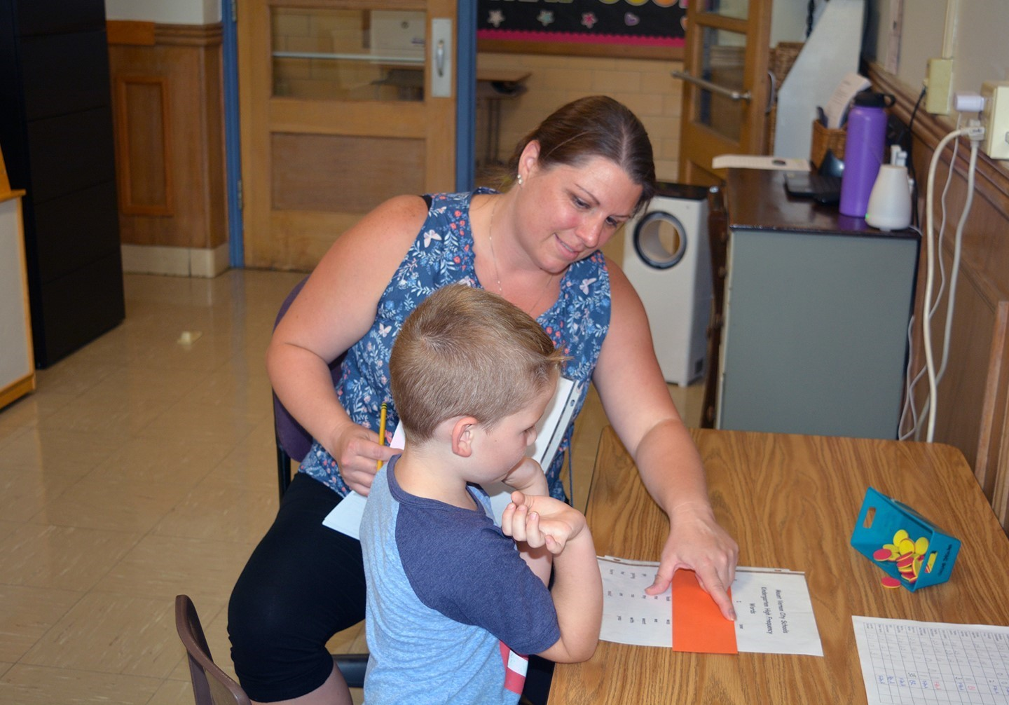 Mrs. Kramp working on reading with her student.