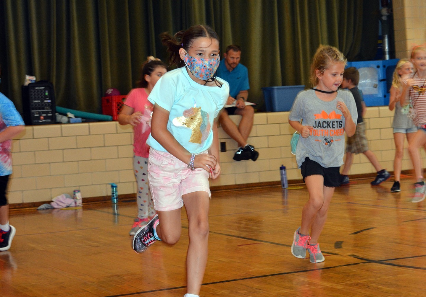 Students running in Mr. Robert's gym class.