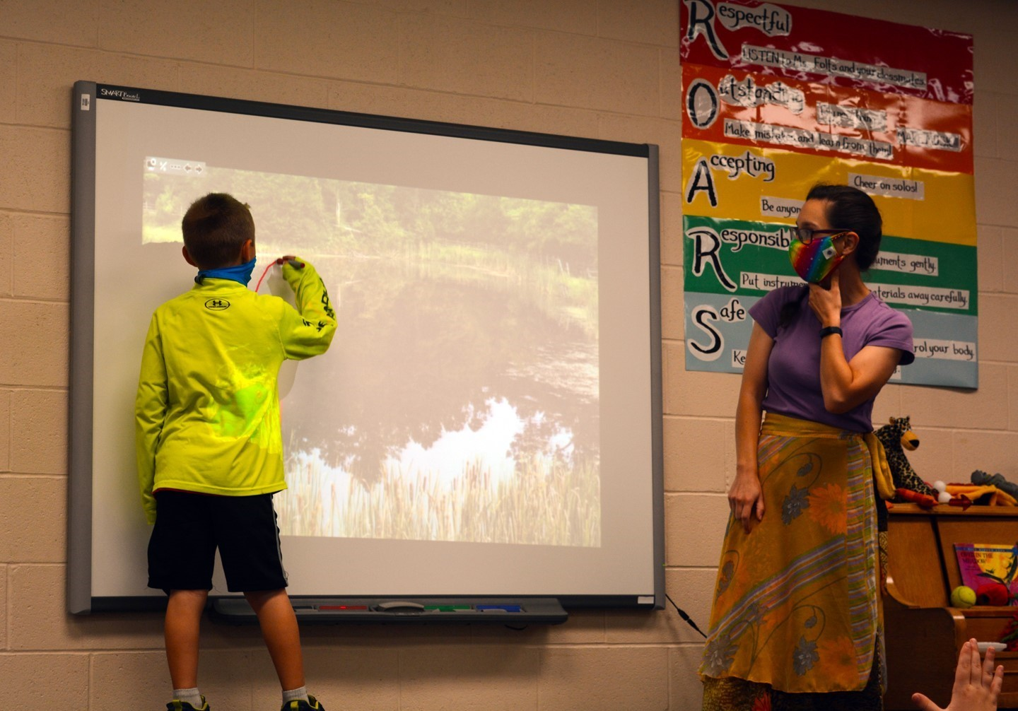 Student drawing on the Smartboard in Mrs. Folts's music class.