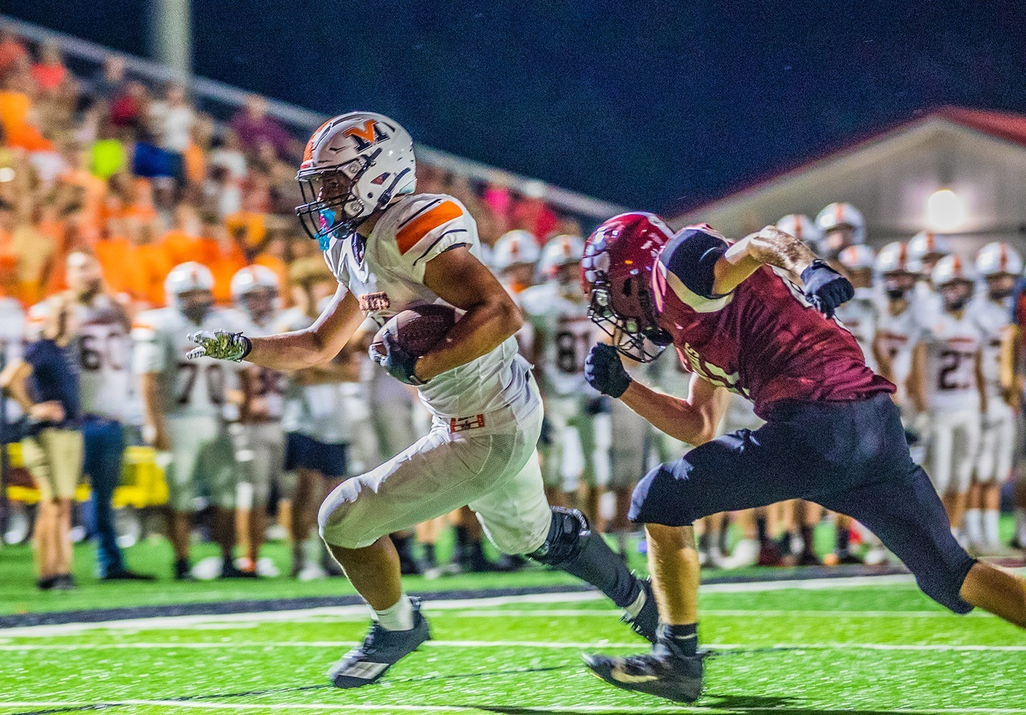 Mount Vernon running back avoiding a tackle during the Newark game.