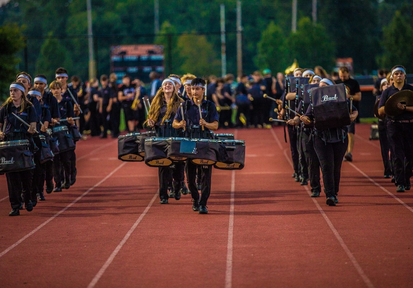 Mount Vernon High School drumline marching down the track.