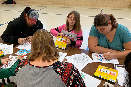 Dan Emmett students and families working on art projects.