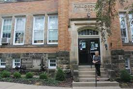 Principal at Wiggin Street Elementary entrance.