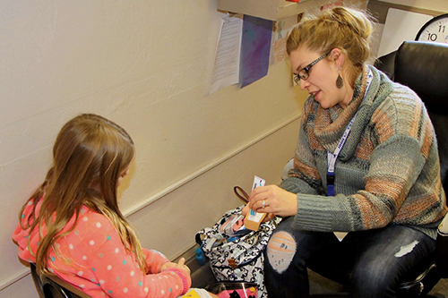 School Health Aide assisting a student.