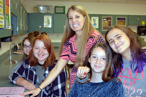 Mrs. Samples and her science students during a lab.