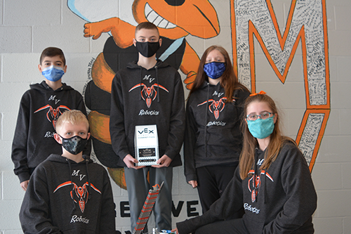 Robotics Team 43050E with their robot and trophy.