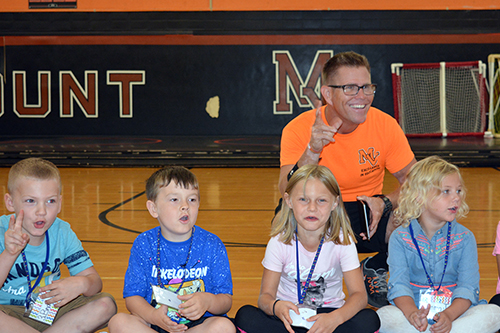Physical Education teacher with students.