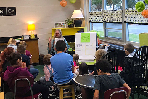 Pleasant Street teacher instructing students.