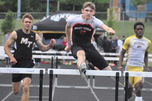 Erich Rhodeback clears the last hurdle winning the State Championship 300 meter hurdles.