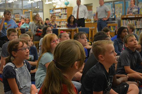 Twin Oak students meeting in the school library.