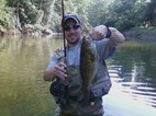 Mr. Farmer holding smallmouth bass while fly fishing on the Kokosing.