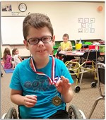 Picture of student winning the gold medal for reading!