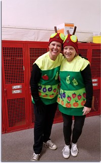 Mrs Kramp and Mrs. Bebout as the hungry caterpillar